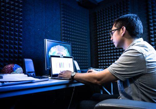 Neuroscience student at computer